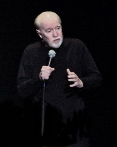 479px-Jesus_is_coming.._Look_Busy_George_Carlin1-239x300